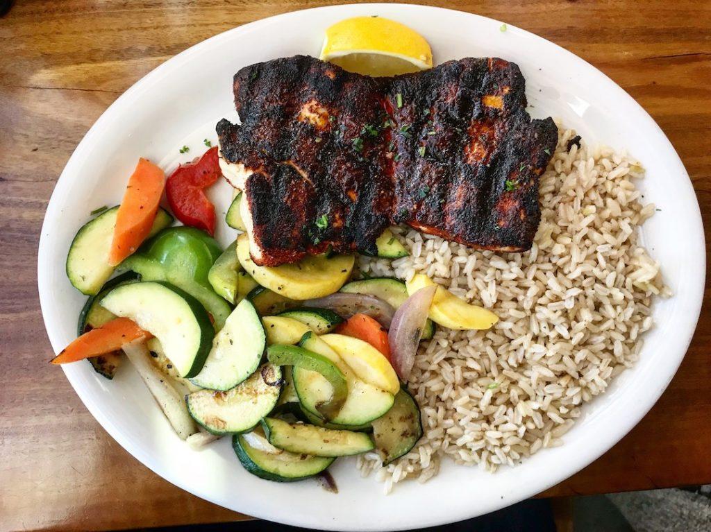 brown rice, veggies, blackened salmon on a plate