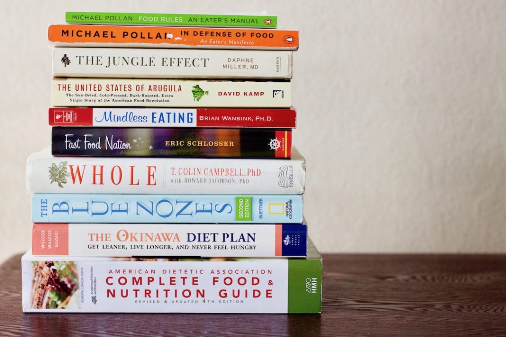 diversity in dietetics - stack of books written by white authors