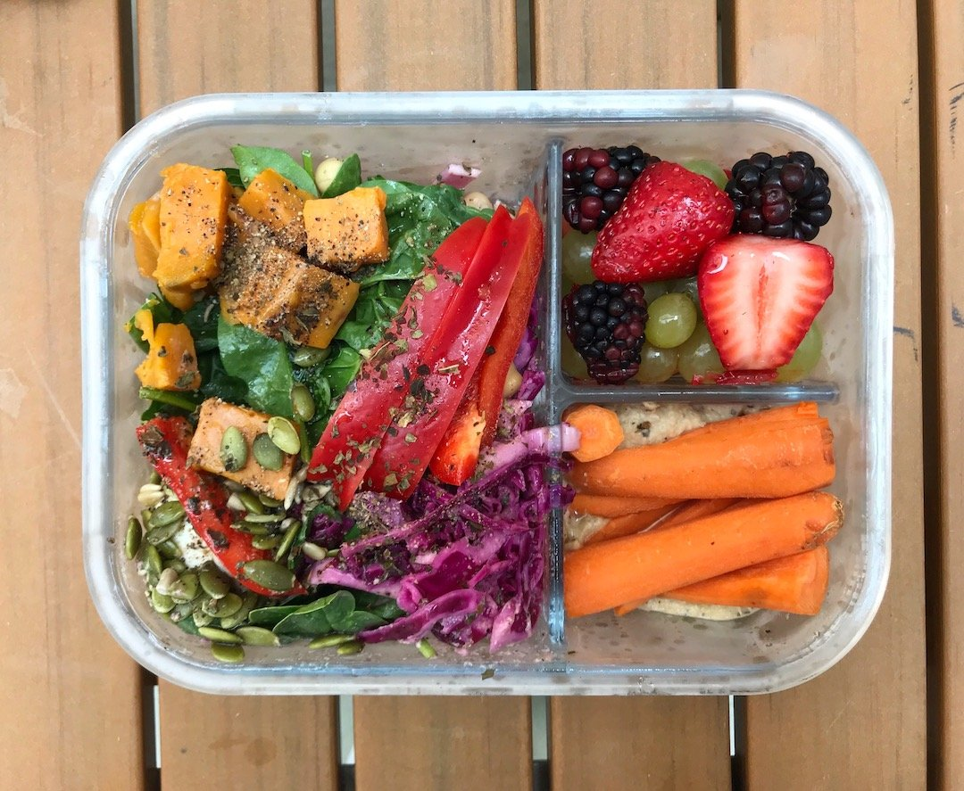 easy healthy lunch: fresh veggies, fruit, and salad in a glass lunch box