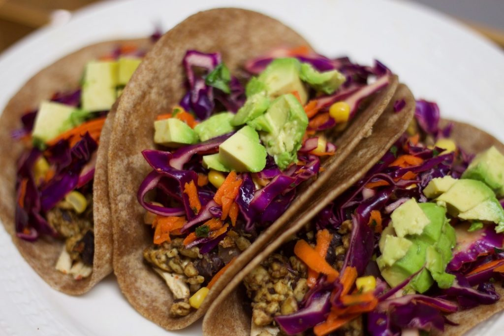healthy family meal ideas: plant-based tacos with avocado and cabbage