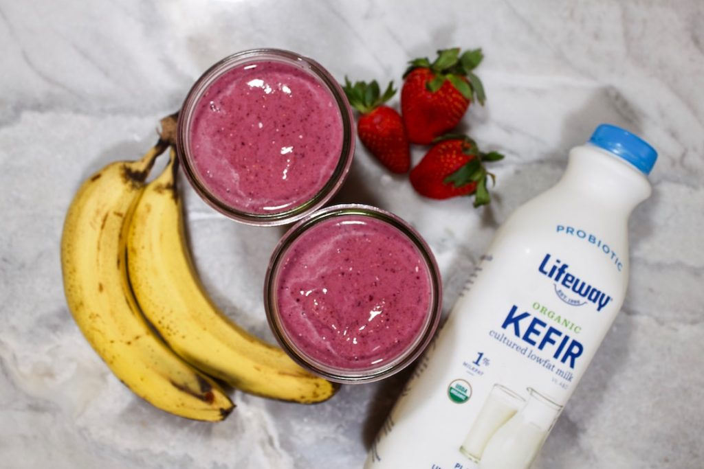 two banana berry smoothies with ingredients
