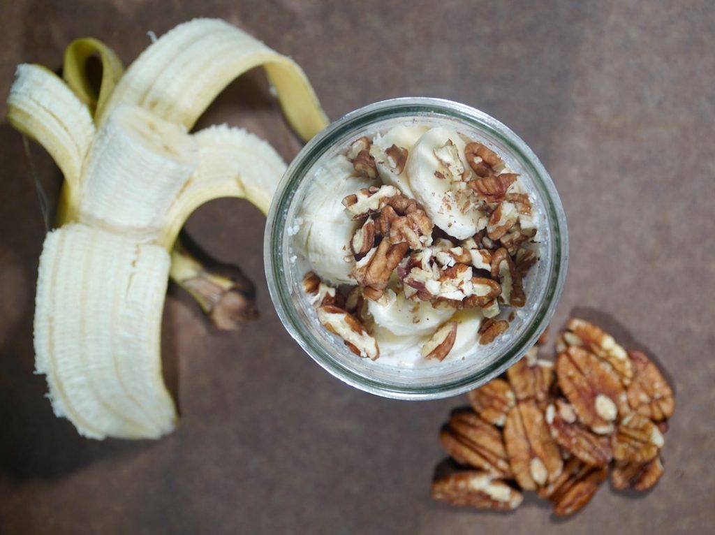 a jar of banana nut overnight oats with pecans