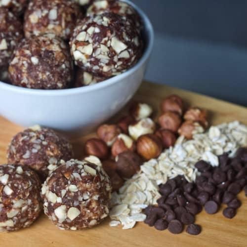 Easy Chocolate Hazelnut Energy Bites with ingredients: oats, chocolate chips, hazelnuts