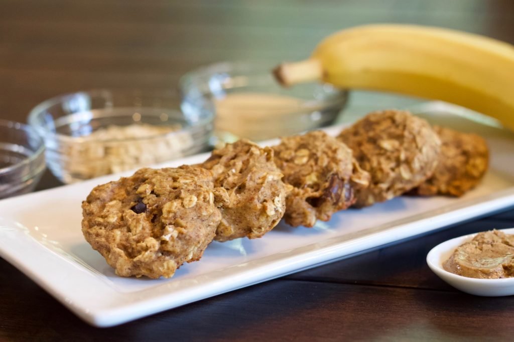 Banana oatmeal cookies with ingredients in the background