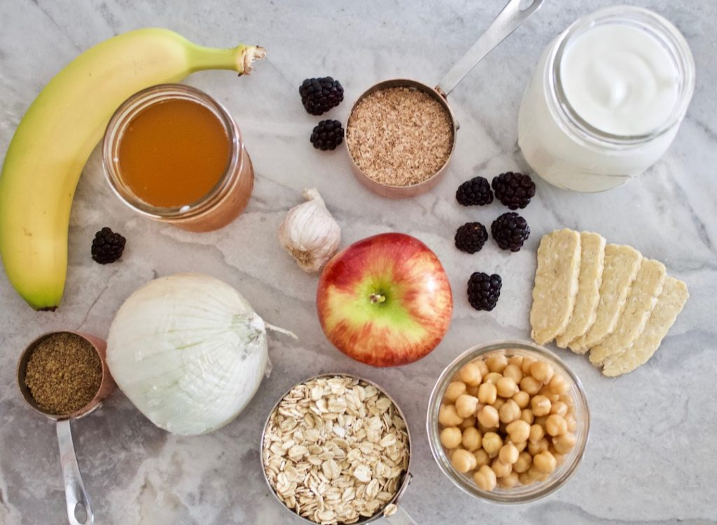 prebiotic and probiotic foods: yogurt, onion, kombucha, beans, flax, oats, apples, banana, garlic, berries, bran, tempeh