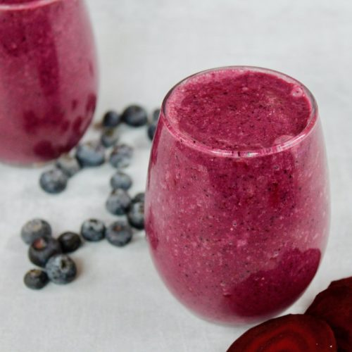 beet blueberry smoothie in a glass cup