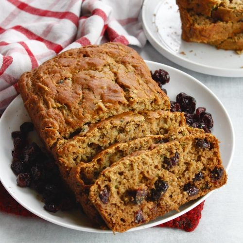 cranberry zucchini bread sliced on a plate