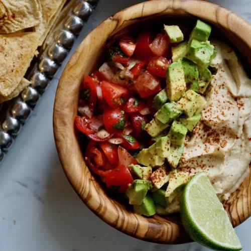 Taco Hummus with pico de gallo, tortilla chips, avocado