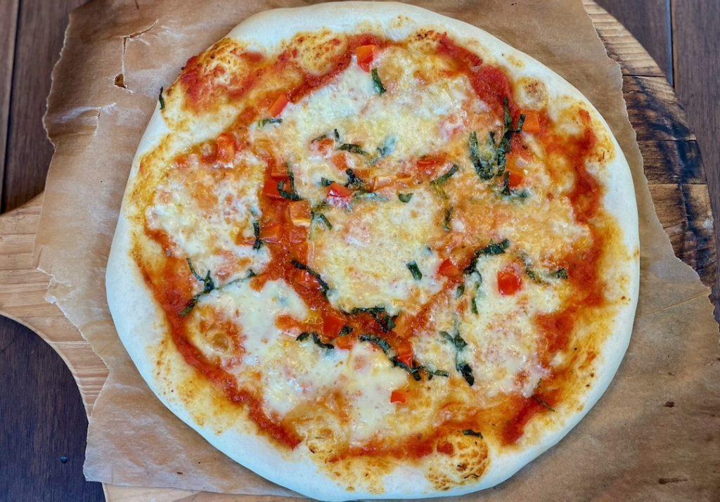 homemade pizza base recipe on a pizza peel