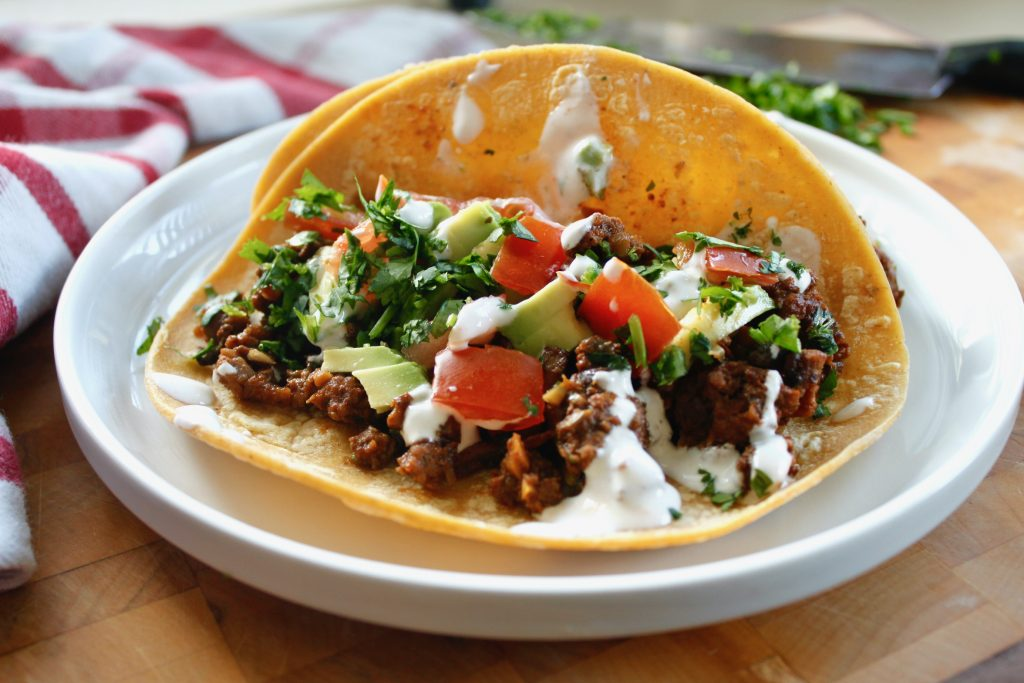 healthy beef tacos with mushrooms on a corn tortilla