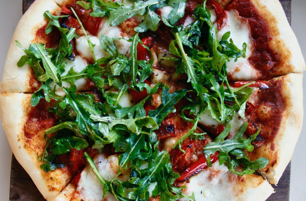 roasted red pepper pizza with arugula
