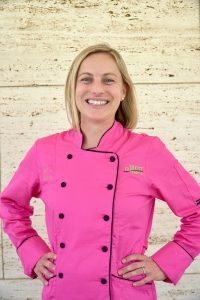 Chef Lindsey Schoenfeld, RDN in a pink chef's coat