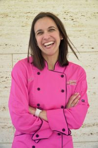 Chef Vahista Ussery, MS, MBA, RDN in a pink chef's coat